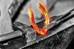 Image depicting horseshoe being forged - to symbolise making your own luck