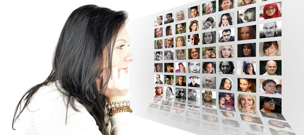 woman looking at montage of faces - emphasising importance of relationships