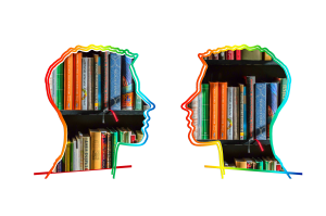 two heads in profile talking to each other - image of books framed inside heads